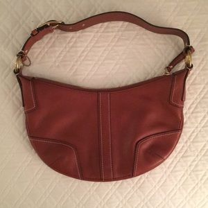 Brown coach purse with adjustable strap